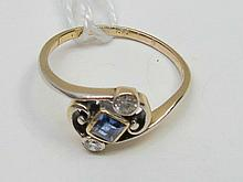 A 9ct yellow gold three stone sapphire and diamond