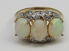 A ring with three cabachon opals at centre with a