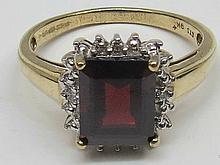 Trap cut garnet ring, claw set central stone