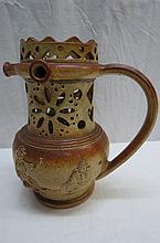 A 19thC stoneware mystery jug of typical form the