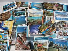 Postcards in shoebox, mainly modern tourist types