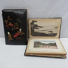 Two Japanese lacquered postcard albums with scenic and cultural views. Some coloured.