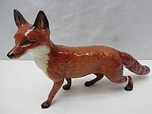A Beswick figure of a large stalking fox.