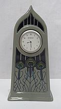 A Moorcroft tall clock with peacock feather