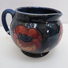 An early William Moorcroft jug with big poppy