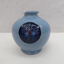 A Moorcroft blue trial vase with floral motifs,
