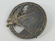 A Blockade Buster badge, eagle at the prow of a
