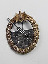 A Nazi Coastal Artillery badge, pierced oval with