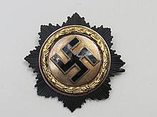 A WWII Nazi Star emblem, swastika within a wreath