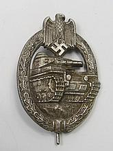 A Nazi tank badge, cast with a tank within an oak
