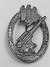 A Nazi Flack badge, the gun within an oval of oak