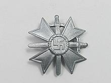 A WWII German Merit badge with crossed swords.
