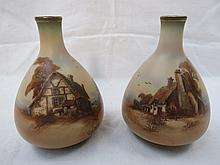 A pair of Royal Worcester ovoid vases, decorated