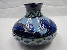 A Moorcroft vase with blue dawn landscape, of