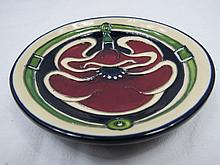 A Moorcroft coaster with petaldome design, dated