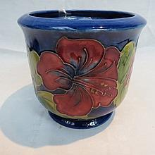 A Moorcroft jardiniere decorated with hibiscus