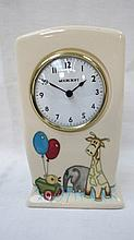 A Moorcroft nursery clock decorated with balloons,
