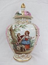 An early 20thC lidded vase of baluster form,