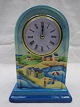 An old Tupton ware mantel clock decorated with a