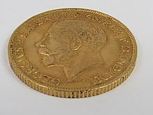 A Victorian gold Sovereign dated 1912