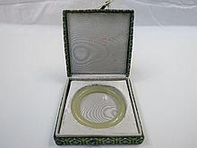 A modern pale green Chinese jade bangle 8cm dia,