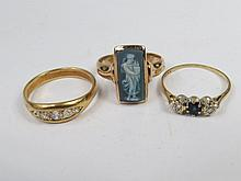 Three rings; a five stone graduated gypsy style