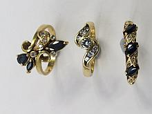 Three dress rings. A sapphire and diamond ring in