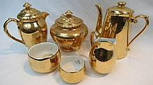 A Royal Worcester gilded teapot, hot water, coffee