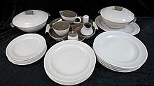 A Poole Pottery two tone dinner service of six