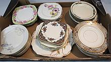 A collection of pretty vintage tea plates and