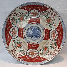 A large late 19thC Imari charger, decorated in a