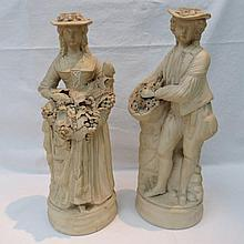 A pair of late 19thC parian figures, the female as