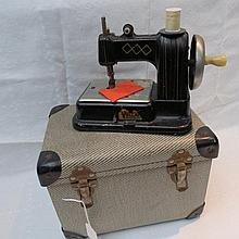 A Vulcan child's tin-plate hand crank sewing