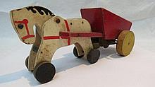 A Chad Valley clockwork horse and cart, the white