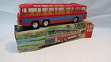 A Laurie Toys motor coach, red cast plastic with