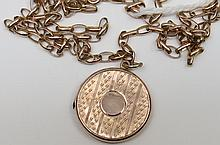 A 9ct rose gold locket and chain engraved front