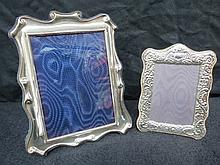 Two HM silver photoframes, measuring 14 and 19cm