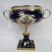 A contemporary gilt metal mounted table centre,