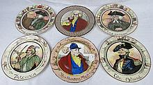 A set of Royal Doulton plates depicting 'The
