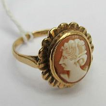 A 9ct cameo set dress ring carved in the form of a