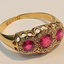 A synthetic ruby and diamond triple cluster ring,