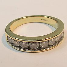 A 9ct nine stone diamond half eternity ring,