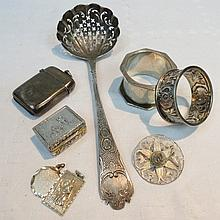 A large ornate Georgian sifter spoon, marked