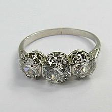 A three stone diamond ring. Old cut brilliants,