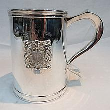 An HM silver pint tankard, with applied armourial