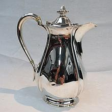 A silver hot water jug, Sheffield 1919, of oval