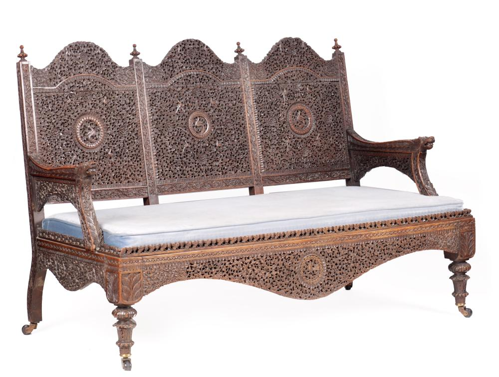 A 19TH CENTURY ANGLO-INDIAN HARDWOOD THREE-SEATER SETTEE