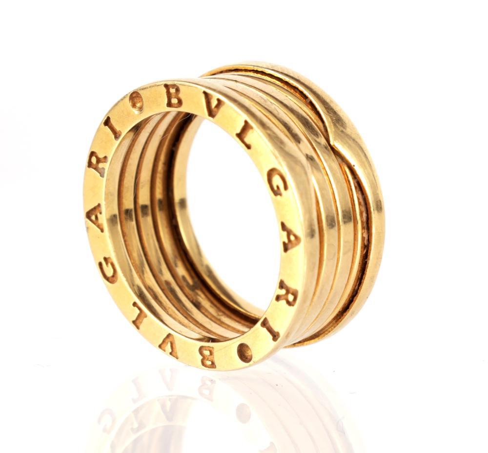 A LADIES 18CT GOLD BULGARI EXPANDING RING