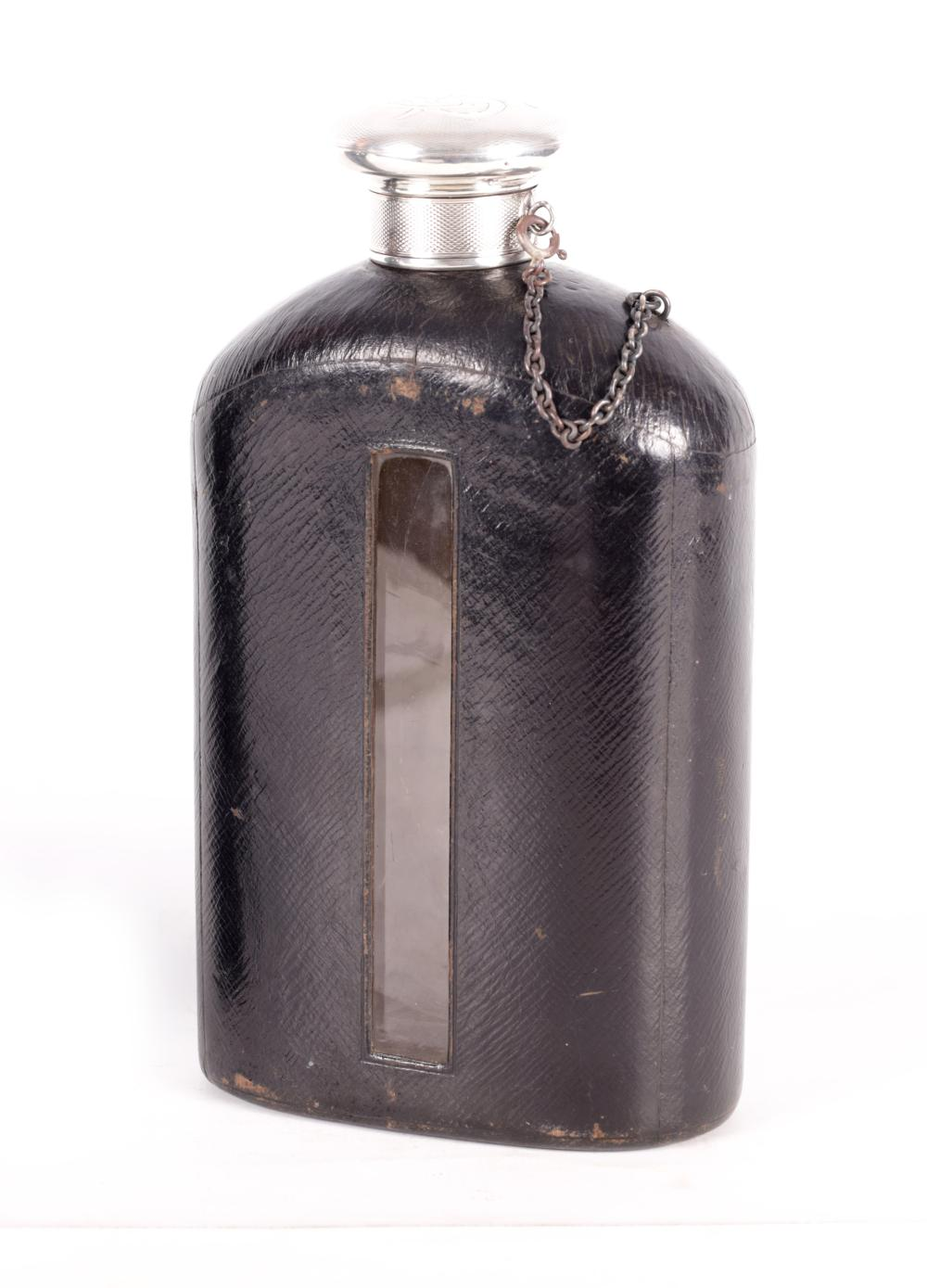 A LATE 19TH CENTURY OVERSIZED SILVER AND LEATHER BOUND HIP FLASK
