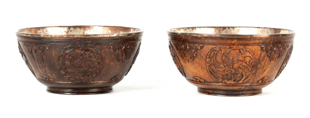 A PAIR OF 19TH CENTURY CARVED COCONUT AND SILVERED METAL BOWLS